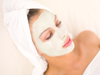 Beautiful skin care treatments - woman getting facial